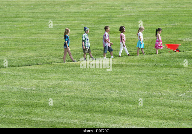 Utah USA group children walking up slope height order - Stock Image