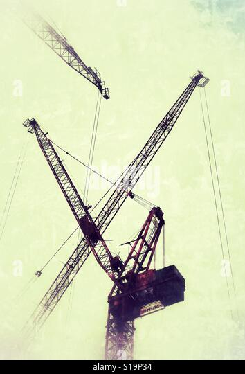 A series of construction cranes - Stock Image