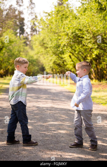 Two brothers together outdoors in a lifestyle portrait with natural light. - Stock-Bilder