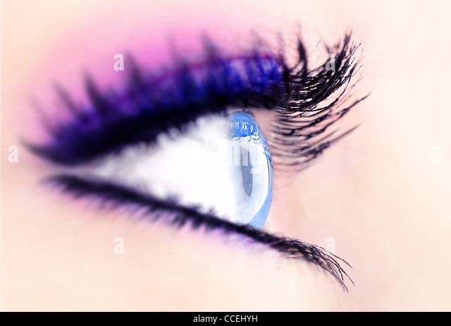 Beautiful abstract blue eye, extreme closeup, with fashionable makeup - Stock Image
