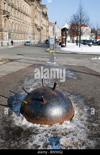 Police headquarters in Dresden, Germany, with a WW2 mine. - Stock Image
