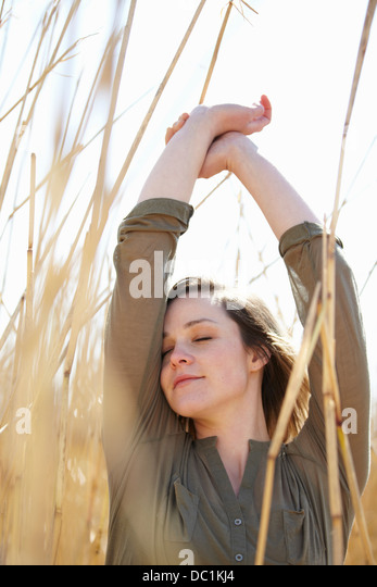 Portrait of young woman amongst reeds - Stock Image