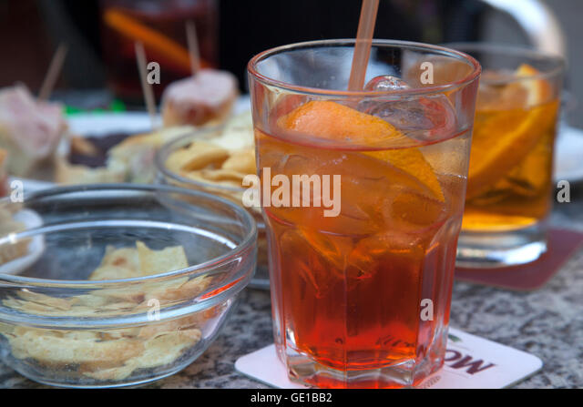An Aperol Spritz with snacks at a table in Levanto, Cinque Terre, Italy. - Stock Image