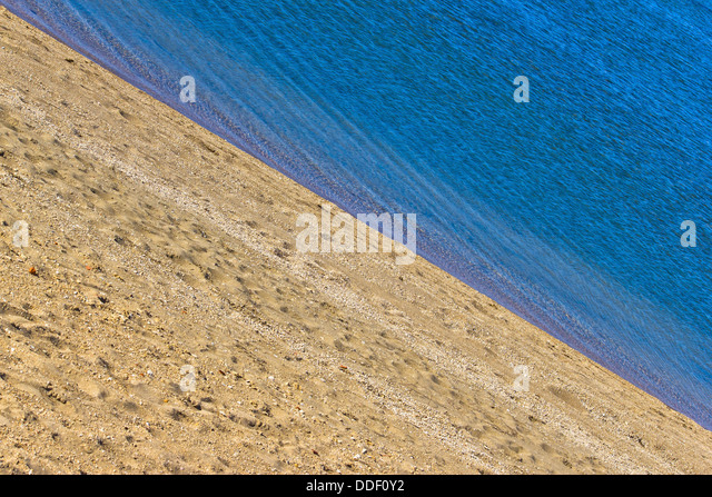 Sand beach and blue sea diagonal layers - Stock Image