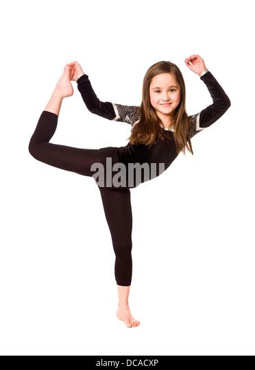 Young girl doing gymnastics - Stock Image