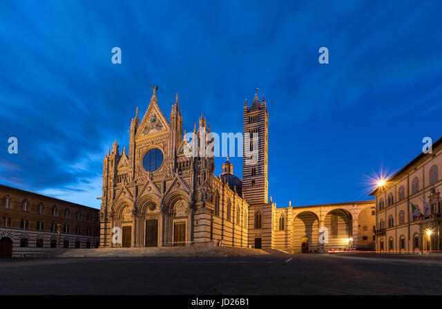 Siena - Italy. The 12th century Siena Cathedral (The Duomo) at dusk. A masterpiece of Italian Romanesque-Gothic - Stock Image