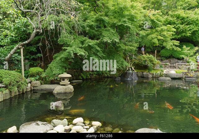 Koi pond stock photos koi pond stock images alamy for Japanese koi pond garden