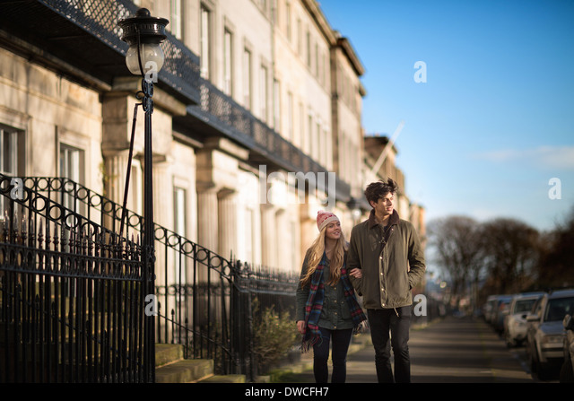 A young couple walk on Regent Terrace in Edinburgh Scotland - Stock Image