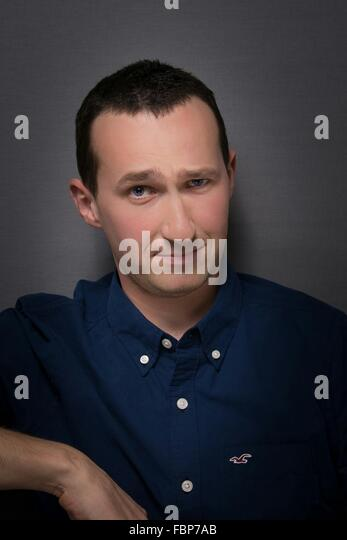 Close-Up Of A Young Man Over Grey Background - Stock Image