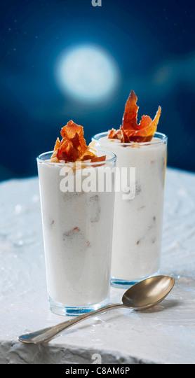 White vegetable emulsion with crisp Serrano ham - Stock Image