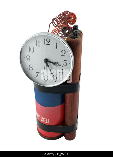 Vintage prop time bomb with large clock and sticks of dynamite. - Stock Image