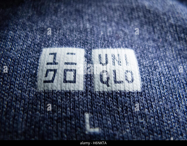 Detail of label on shirt manufactured by Japanese retailer Uniqlo - Stock Image