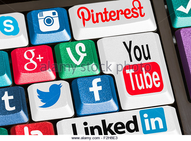 Buttons on a computer keyboard linking to various social media websites. Social networking. Social networks. - Stock Image
