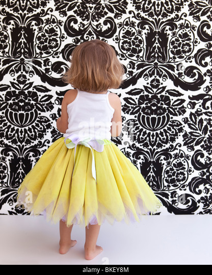 Little girl with yellow tutu - Stock Image