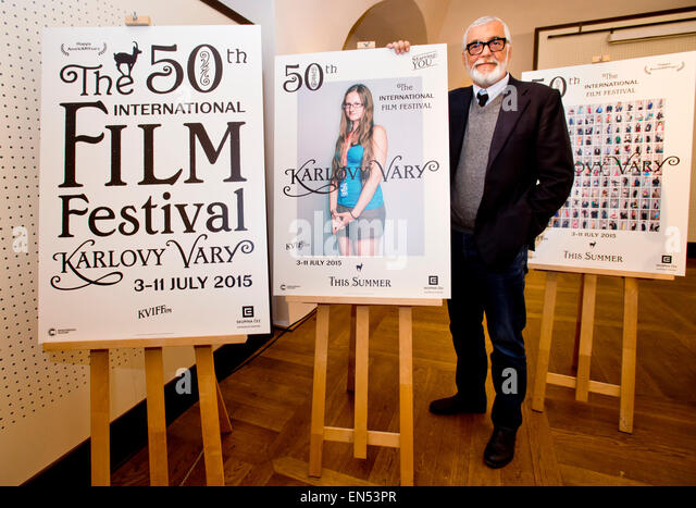 Wednesday. 28th Apr, 2015. Karlovy Vary International Film Festival President Jiri Bartoska unveils a festival poster - Stock-Bilder