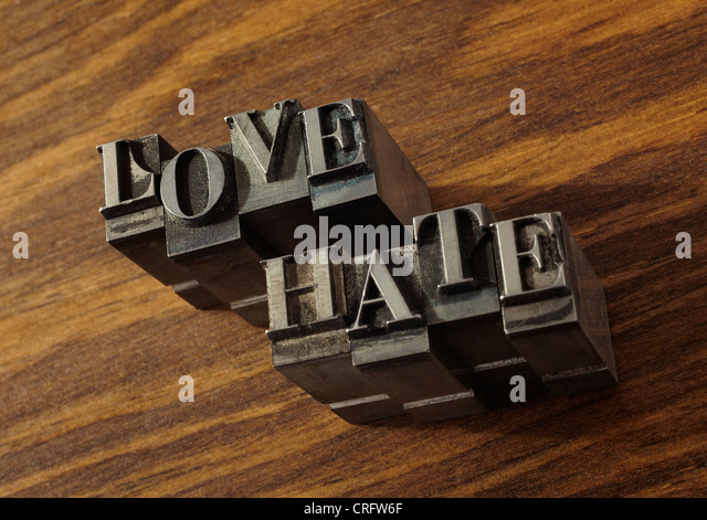 Lead type spelling 'love' and 'hate' - Stock Image
