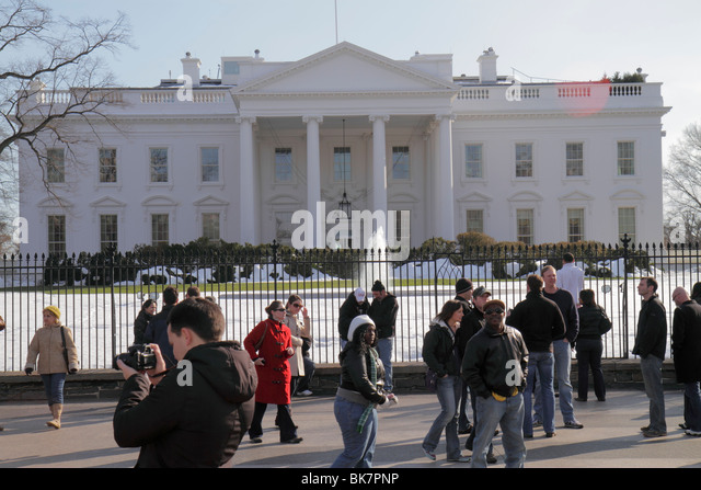 Washington DC 1600 Pennsylvania Avenue The White House President home presidency government Black woman man snow - Stock Image