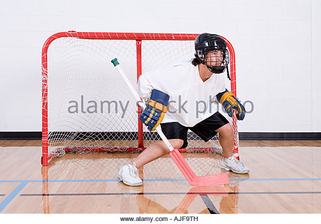 Hockey goalkeeper in goal - Stock Image