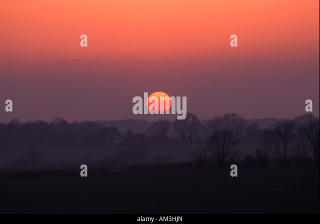 Sunset over fields - Stock-Bilder