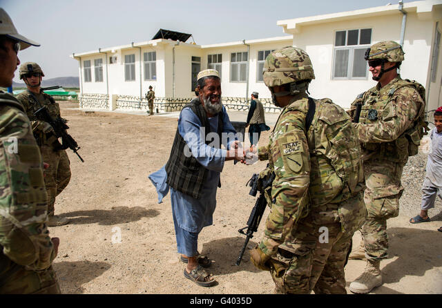 Members of the Kentucky National Guard meet with local Afghans. - Stock Image