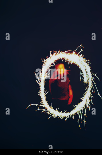girl with sparkler - Stock Image