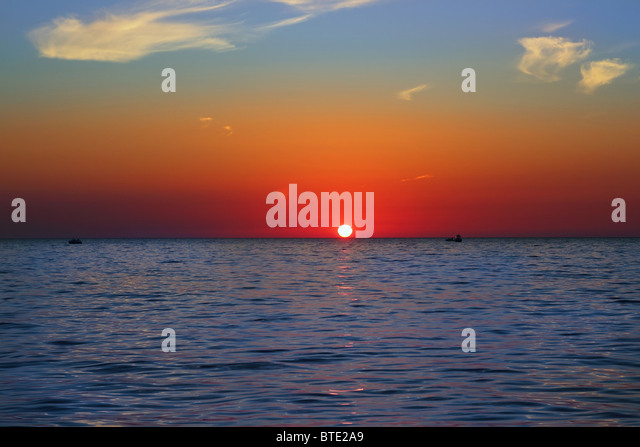 blue golden sunrise seascape sea ocean red golden colorful - Stock Image