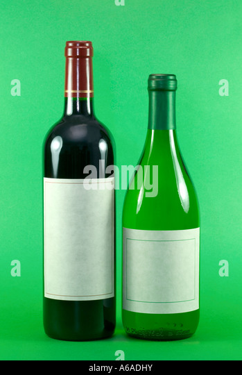 Red and White Wine Bottles with blank labels - Stock Image