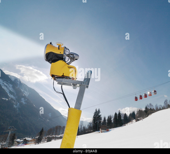 Snowblower and cable car in ski resort - Stock-Bilder