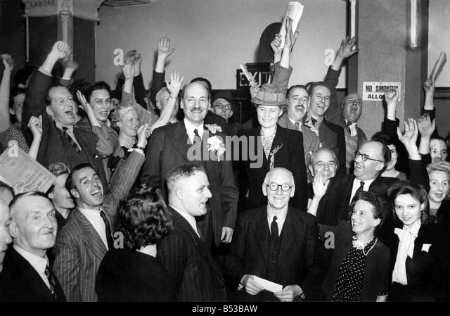 New Prime Minister Clement Attlee celebrates with supporters after labour's surprise victory in the General - Stock Image
