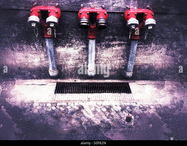 Three fire hoses on the road - Stock Image