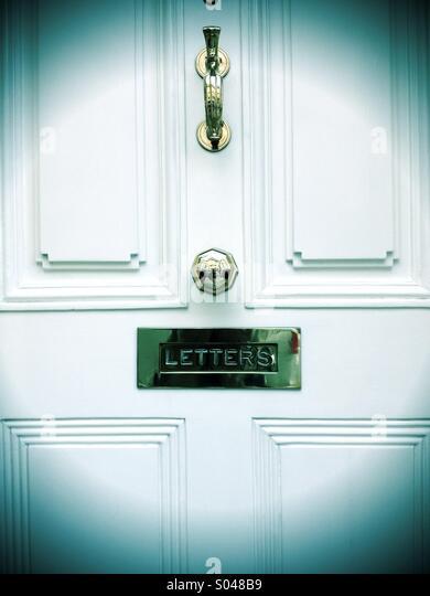 Brass on front door - Stock Image