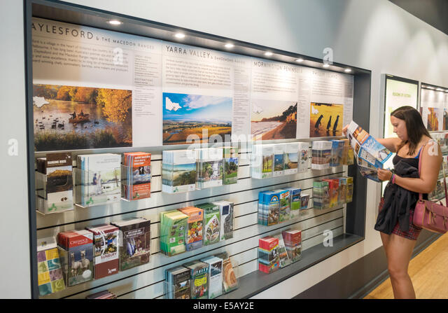 Melbourne Australia Victoria Central Business District CBD Federation Square Visitor Centre center brochures information - Stock Image