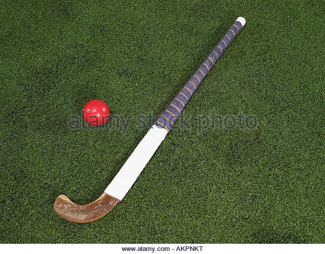 A hockey stick and a ball - Stock Image