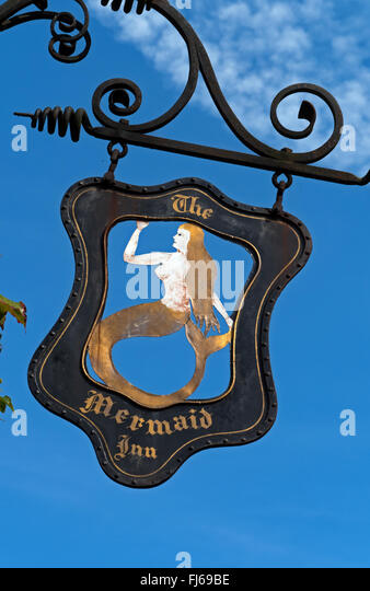 The Mermaid Sign, above The Mermaid Inn, on the famous cobbled Mermaid Street in Rye, East Sussex, England - Stock Image