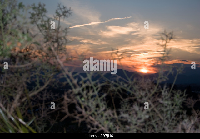 Sunset in hills above Fuengirola, Spain, evening sunlight dusk Sierra Blanca country side countryside rural rustic - Stock Image