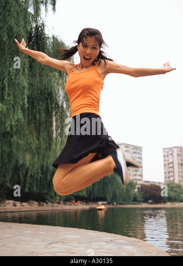 a chinese young woman upspring - Stock Image