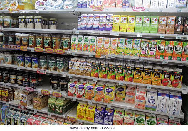 Tokyo Japan Shinjuku kanji hiragana katakana characters symbols Japanese English Lawson Convenience Store business - Stock Image