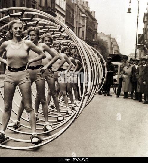 Wheel gymnastics 1931 Berlin Germany Europe women spectators presentation Wintergarten repertory theatre Cen - Stock Image