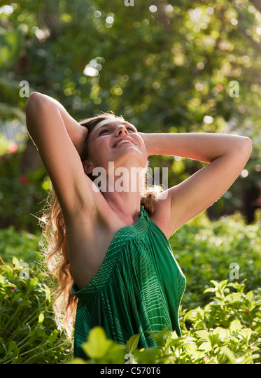 Woman standing in forest - Stock Image