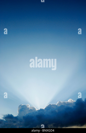 Rays of light above clouds - Stock Image