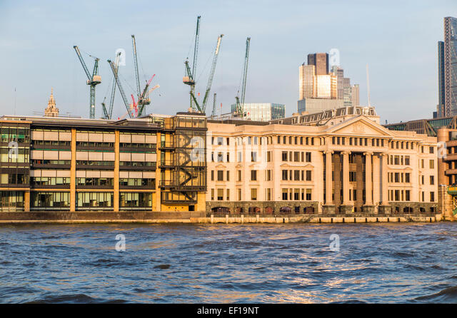Stanhope tower cranes on the London skyline on the Bloomberg Place site in the City of London, EC4 across the River - Stock Image