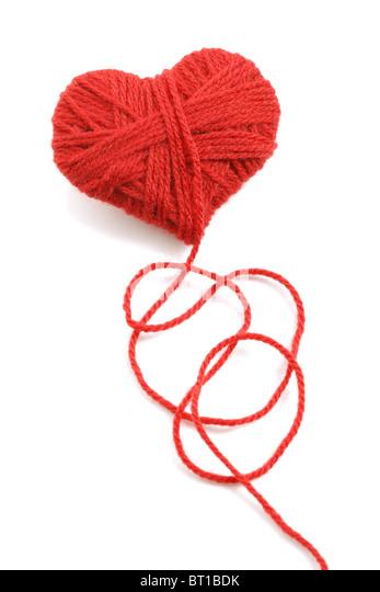 Yarn of wool in heart shape symbol - Stock Image