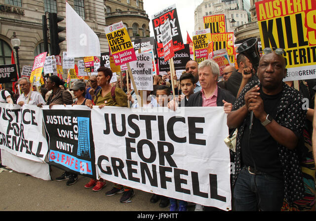 London, UK - 1 July 2017 - Demonstrators holding 'Justice for Grenfell' seen on Regent Street during a demonstration - Stock Image