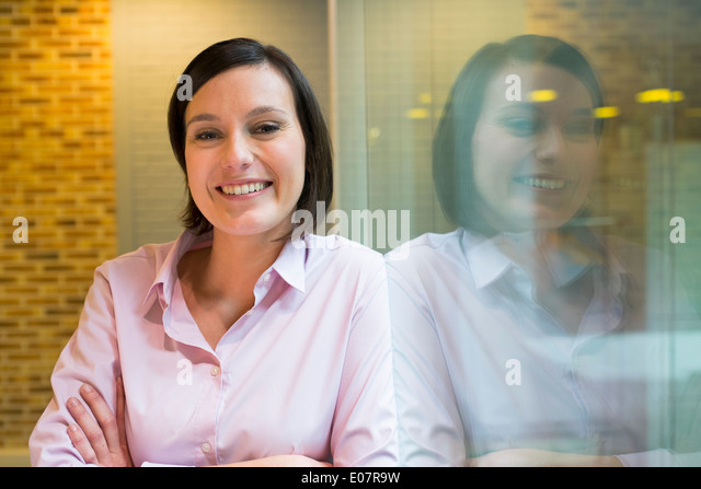 Female business startup looking camera student - Stock Image