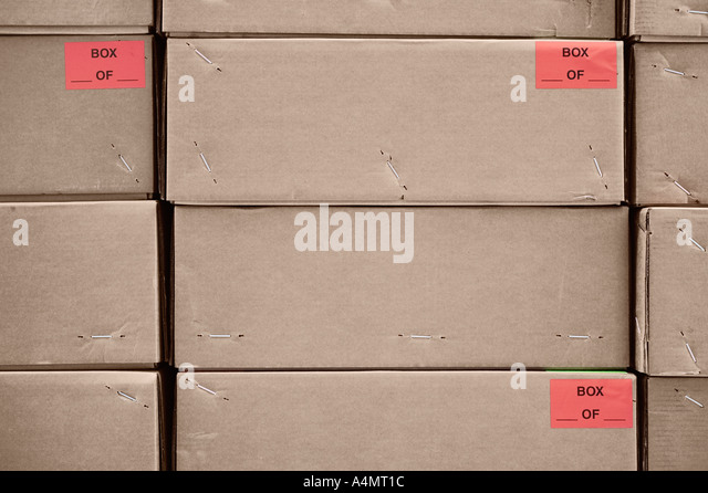 Urban Type Red Labels On Stacked Storage Boxes - Stock Image