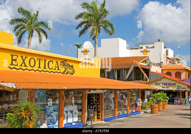 Cozumel Mexico San Miguel town bright yellow shopping plaza - Stock Image