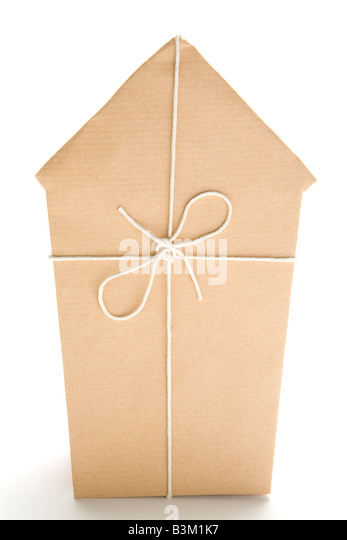 Studio Shot Of House Wrapped In Brown Paper And Tied With String - Stock Image