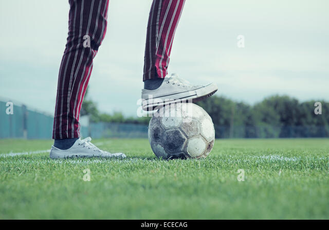 Low section of man with soccer ball - Stock Image
