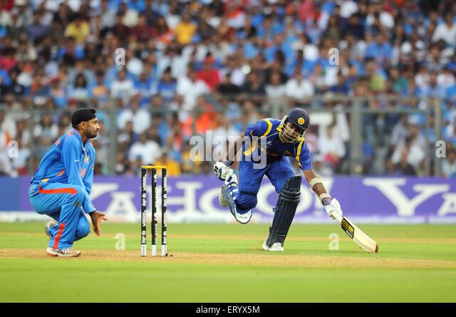 Sri Lankan batsman reaches crease bowler Harbhajan Singh tries ICC Cricket World Cup finals Wankhede stadium Mumbai - Stock Image