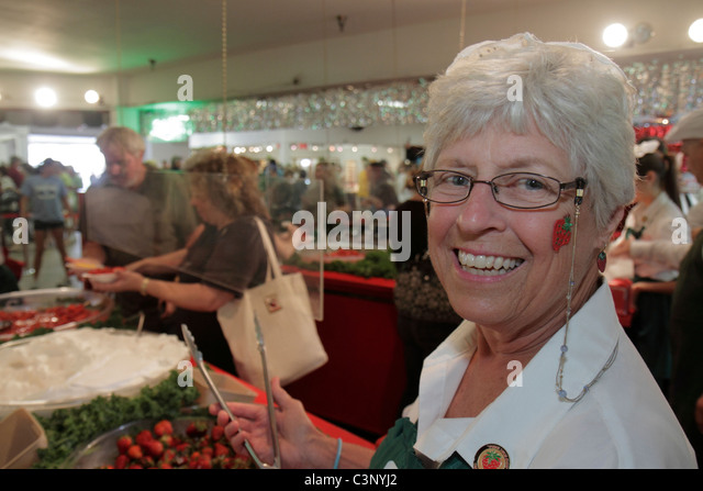 Plant City Florida Florida Strawberry Festival annual event shortcake make your own senior woman cheek decal - Stock Image